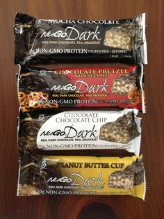 NuGo Dark Bars -- Non-GMO, gluten free, 10 grams of protein, and real dark chocolate.  My favorite is the chocolate pretzel with sea salt!  I have purchased them at Whole Foods and The Fresh Market.