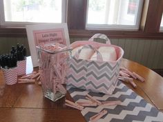 Pink and Gray Bird Themed Shower--Diaper Game:  Guests write funny phrases on diapers for late-night changes.