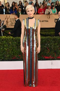 The SAG Awards 2017 Red-Carpet Looks. Michele Williams channels Gatsby's Daisy, in an Art Deco inspired, Jazz Age look, by Louis Vuitton.