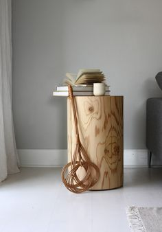 Stump looking side table that can also be used as a pair, or trio, as coffee tables too!