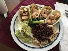 Tonight we have.. Grilled Chicken Tacos Beans and Rice  Side salad w/ Homemade Guacamole made with Fire roasted tomatoes and chilies