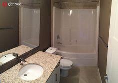 bathroom with granite countertops and tile, backsplash tile at 5625 Glide Crescent, in Harbour Landing