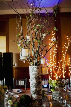 Branches with hanging candles in birch container | photography by http://www.sloanphotographers.com/