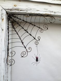 Czechoslovakian Purple Spider Dangles From 12 Barbed Wire Corner Spider Web via Etsy Metal Tree Wall Art, Metal Art, Barb Wire Crafts, Wire Hanger Crafts, Wire Hangers, Wire Spider, Spider Webs, Barbed Wire Art, Barbed Wire Wreath