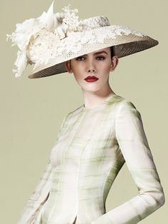 Hat by Phillip Treacy. - sublime. excellent proportions: the width of the hat is perfectly balanced by the size and architecture of the bow and flowers. the detailing (the textures of the notions, the lace and applique on the brim) adds the finishing touches. treacy often ventures into the realm of the fantastic and impractical, but this is eminently wearable and elegant without being boring.