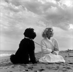 0 French Actress Martine CAROL with her poodle on the beach