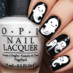 Who wouldn't allow these adorable ghosts to haunt their fingertips? Just look at their sweet little smiles and pink cheeks.  See more at Nails By Cambria »