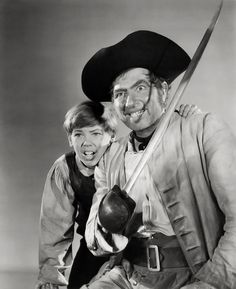 Robert Newton - Bobby Driscoll - Treasure Island - Movie Still Poster Disney Animated Films, Disney Movies, Treasure Island Movie, Bobby Driscoll, Robert Newton, Long John Silver, Buddy Holly, Star Wars, Golden Age Of Hollywood