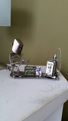 Check out this item in my Etsy shop https://www.etsy.com/listing/242846463/custom-made-scrap-metal-art-tug-welder
