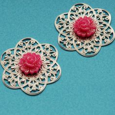 2 vintage silver tone metal findings with pink plastic flowers. $3.20, via Etsy.