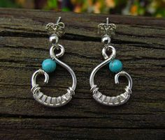 Sweet little chunky swirls! This listing is for a pair of turquoise earrings intricately wrapped in sterling silver wire and finished with swirls. They measure 7/8 of an inch long, including the sterling silver post ear wires, and 1/2 inch at their widest point. All pieces come with an