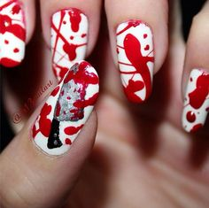 This nail art is super easy and super scary. It's the perfect nail choice for Halloween.