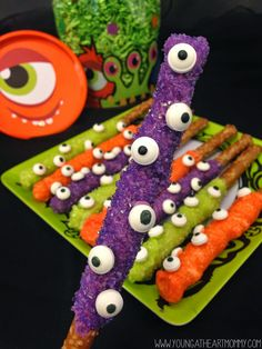 Pretzel rod candy treats for Halloween party snack table! Monster eyeballs. Colorful creepy cute.