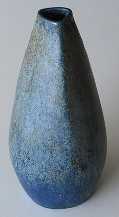 A blue stoneware vase from the Hjorth ceramic studios on the island of Bornholm, in Denmark.