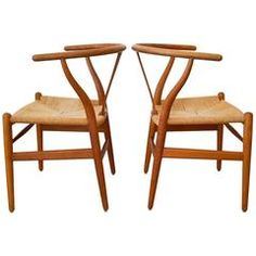 Pair of Hans Wegner CH 24 Wishbone Chairs | From a unique collection of antique and modern dining room chairs at https://www.1stdibs.com/furniture/seating/dining-room-chairs/