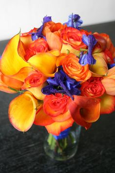 Orange and blue wedding flower bouquet, bridal bouquet, wedding flowers, add pic source on comment and we will update it. www.myfloweraffair.com can create this beautiful wedding flower look.
