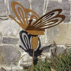 Achla Designs Garden Stake, Butterfly by Achla. $19.99. Made from unbreakable cast aluminum. Measures 14-inch w by 12-inch h, 36-inch l stake. Hand painted with uv resistant paint. Oversize beautifully shaped butterflies, tulips, bachelor's buttons are offered in rust finish to contrast against the greenery.