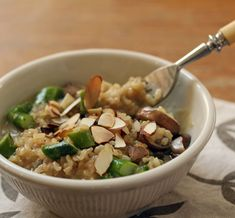 Brown rice risotto with asparagus, mushrooms and almonds -- made fast and easy in the pressure cooker. [ThePerfectPantry.com]