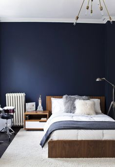 Gorgeous combination of deep denim blue and warm timber tones. Looking for blue bedding and solid wood beds? Try: http://www.naturalbedcompany.co.uk/