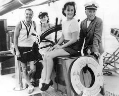 Norma Shearer, Paulette Goddard, Charlie Chaplin, and Franklin Ardell off the coast of Catalina Island