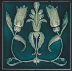 Elegant art nouveau double poppy with a faintly gothic note carved in high relief and finished with a beautifully pooled glaze from Corn Brothers, c. 1895-1904. Tile is in excellent original condition...