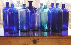 Vintage apothecary blue bottles featured on I Antique Online.com. Visit http://iantiqueonline.ning.com/