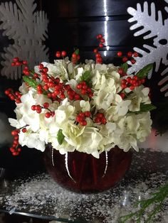 Christmas flower arrangement!!! Bebe'!!! Festive centerpiece that is elegant but easyand inexpensive to do...uses white carnations and contrasting red berries!!!