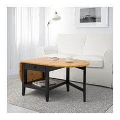IKEA - ARKELSTORP, Coffee table, , Solid wood is a durable natural material.A coffee table with drop leaves is easy to make larger or smaller according to your different needs.Pull-out stop ensures that the drawer cannot be pulled out too far accidently.Practical storage space underneath the table top.Separate shelf for magazines, etc. helps you keep your things organized and the table top clear.