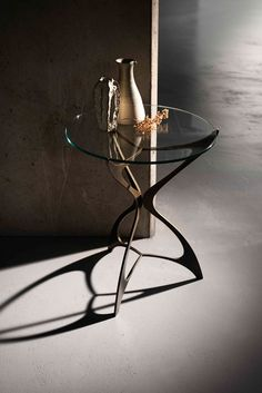 Opera #side_table finished in Rose Pewter with a #glass_top.