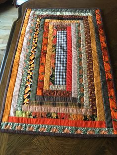 Handcrafted Thanksgiving/Fall quilted rectangular table runner featuring fall colors including browns and oranges Quilted Table Runners Christmas, Table Runner And Placemats, Table Runner Pattern, Fall Table Runner, Strip Quilts, Mini Quilts, Colchas Country, Halloween Quilts, Handmade Table