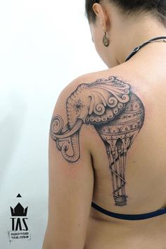 Tattoo artist Rodrigo Tas turns an elephant into a hot air balloon in this creative dotwork tattoo.