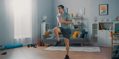 Strong Athletic Fit Man in T-shirt and Shorts is Energetically Jogging in Place at Home in His Spacious and Bright Living Room with Minimalistic Interior. - Buy this stock photo and explore similar images at Adobe Stock Thigh Toning Exercises, Toning Workouts, At Home Workouts, Weight Workouts, Workout Days, Cardio Routine, Fitness Workouts, Post Workout, Workout Challenge