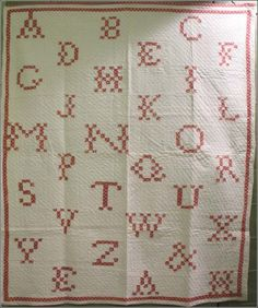 "ALPHABET POSTAGE STAMP ANTIQUE QUILT red and white -   A most unusual Alphabet quilt that looks like a needlework sampler thanks to the 1"" postage stamp squares used to create the letters. Cross-stitch-looking lettering like this appears in some early 19th century quilts with words and names, check the sites at Historic Deerfield and other museums."