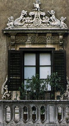 Ornamental header over a window in Palermo, Sicily, Italy • original source not found