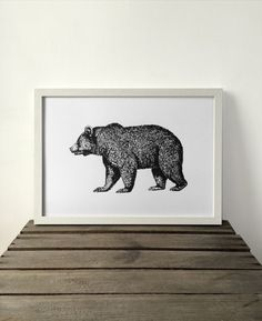Bear Art Print, A3 screen print, home decor, wall decor, print, gift.  All prints are entirely handmade and are unique pieces, as such each product might vary slightly. Materials: white thick paper (250gsm), black thick paper (250gsm), water based black ink, water based Gold ink, silk screen.  Size: 29,7 cm x 42cm / A3    Print is sold without mount or frame.  Every piece will arrive carefully packed in a solid cardboard packaging tube. Is this a gift? We have a selection of hand…
