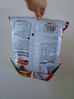 Chip bag origami ... no need for pegs ever again. For Patrick, the regifter.