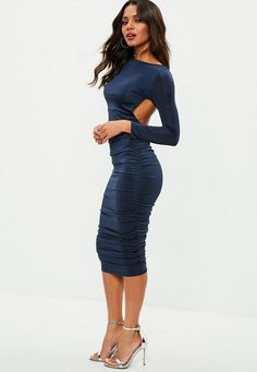 This navy midi dress features ruched details, an open back and long sleeves.