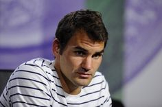 Roger Federer of Switzerland speaks to members of the media during a press conference on day three of the Wimbledon Lawn Tennis Championships at the All England Lawn Tennis and Croquet Club on June 26, 2013 in London, England