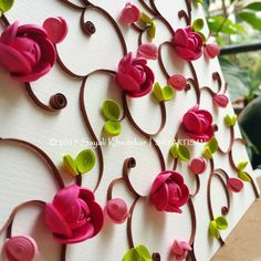 Pink button roses; paper quilling by artist Sayali Khedekar.