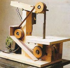 Homemade belt sander. Site is Russian but Chrome will translate it. Site also has other shop-built machines.