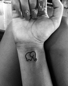 Lovely and Cute Elephant Tattoo Design (24)