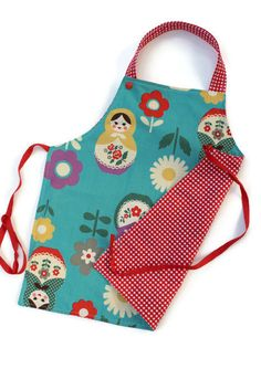 For cooking, gardening or crafts, this apron will please your little ones! A great gift for a toddler or preschooler! Made from designers fabrics Material : cotton adjustment to the neck with two plactics snaps Fit for kids from 2 to 8 size : 16 inch X 14 inch This listing is for ONE apron! Please note: Due to fabric placement this item may be a little bit different from the picture. The last picture is to show the snaps. The other aprons pictured are available in the APRON section of my ...