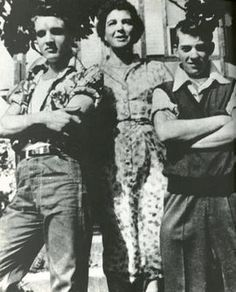 Elvis as a teenager, with two neighbors. Still a growing boy, but already confident - look at his body language.