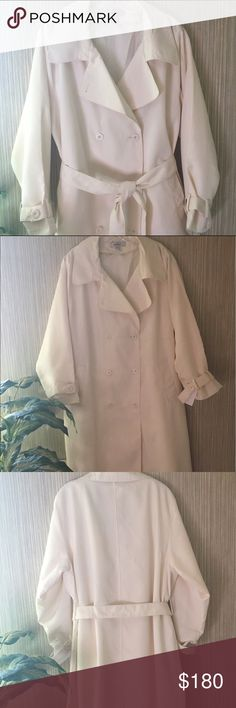 """NWT Avenue by Jessica London Trench Coat, 18W. NWT Avenue by Jessica London Ivory, Fully Lined, Double Breasted Coat. Size 18. Shell: 100% Polyester. Lining: 100% Polyester. Liner: 100% Acrylic. Length: Approx. 51"""". Bust: Approx. 26.5"""". Sleeve length: Approx. 26.5"""". Has slanted pockets in the front, belt for waist and extra buttons.                 Machine wash in cold, on delicate and tumble dry, removing promptly.                         Perfect coat for these chilly mornings we've been…"""
