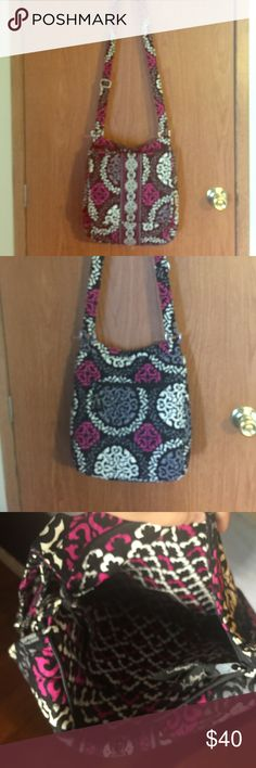 Vera Bradley Crossbody Messenger Bag This messenger bag is a great size! It's magnetic flap open up to two large pockets on the outside and the bag itself it zip to close! There is also a zipper pocket on the back. This bag is brand new only carried a couple times looks great! Vera Bradley Bags Crossbody Bags