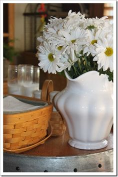 White pitcher filled w/daisy's