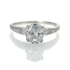 Leigh Jay Nacht Inc. - Engagement Rings- Art Deco Inspired Engagement Ring. 1 Ct. Center Diamond, accent diamonds in the filigree setting...So very sweet and vintage and chic.