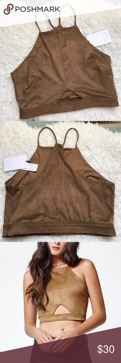 NWT Kendall and Kylie crop top NWT Kendall and Kylie suede crop top in LARGE. triangle cut out in the front. No trades please Kendall & Kylie Tops Crop Tops