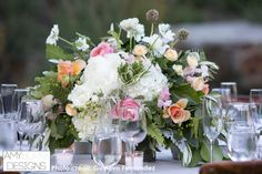 A close up of the details from this table reception centerpiece. The layers of the various flowers make an eye catching floral arrangement. #gardeninspired