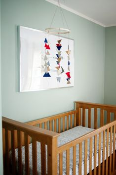 DIY Triangle Mobile - love this modern touch in a nursery!